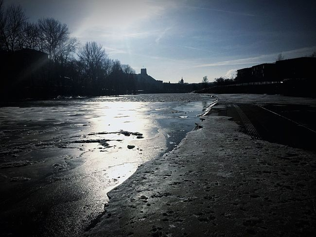 The City Light Frozen River Icy Riverbed of Vilnius Sky Cold Temperature No People Low Angle View Vilnius City Landmarks
