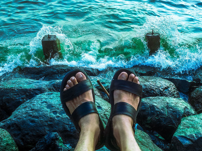 Let the water rage while you keep yourself calm. Outdoors Feet Raging Waves Bay Manila Bay  Water Nature Blue Green  Rocks Manila Calm Sandals