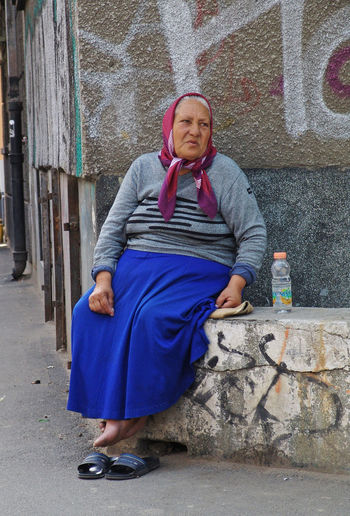 Refreshing in the middle of the way Beverage Blue Bottle Bucharest Casual Clothing Day Drink Leisure Activity Lifestyles Nestea Old Outdoors Outside Portrait Relax Rest Senior Sitting Woman Envision The Future Everyday Emotion People And Places This Is Aging