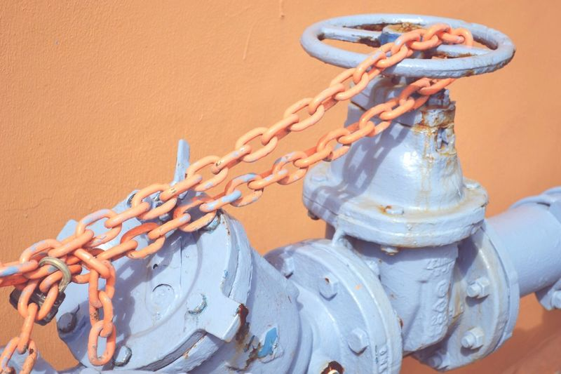 Close-up of chain on valve