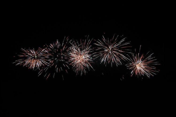 Fireworks in the Marina di Bibbona Night Firework Firework Display Illuminated Celebration Motion Event Arts Culture And Entertainment Long Exposure Exploding Glowing Low Angle View No People Copy Space Firework - Man Made Object Sky Blurred Motion Sparks Dark Light Black Background Explosive