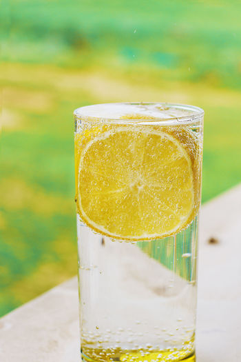 Citrus Fruit Close-up Drink Drinking Glass Focus On Foreground Food Food And Drink Freshness Fruit Glass Glass - Material Healthy Eating Household Equipment Lemon Lemon Soda No People Non-alcoholic Beverage Outdoors Refreshment Still Life Table Yellow