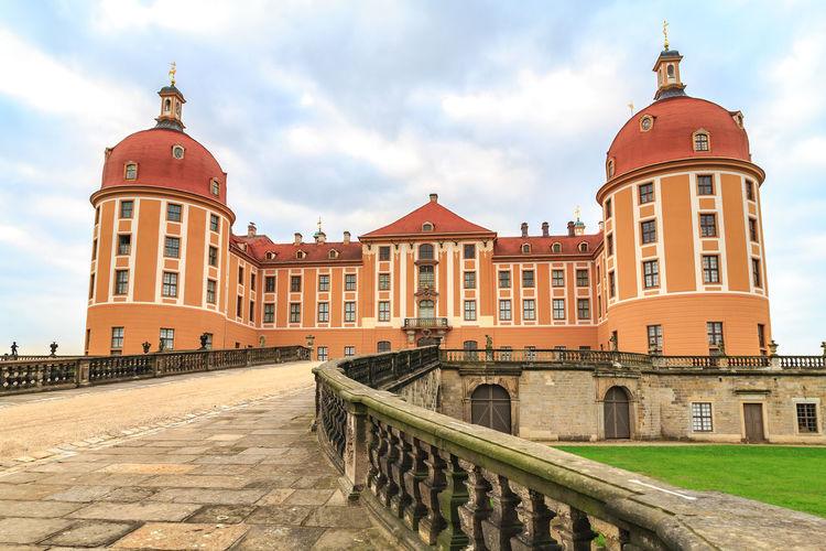DRESDEN, GERMANY - CIRCA AUGUST, 2008: The Palace Moritzburg alias Schloss Moritzburg near Dresden in Germany Schloss Moritzburg, Architecture, Building, Castle, Culture, Destinations, Europe, European, Exterior, Germany, History, Luxury, Old, Palace, Park, Tourism, Traditional, Travel, Yellow, Architecture Built Structure Building Exterior Sky Cloud - Sky Building The Past History Travel Destinations No People Day Outdoors Nature Railing City Travel Dome Tourism Tower Religion