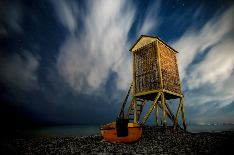 Atmospheric Mood Built Structure Cloud Cloud - Sky Cloudy Connection Engineering Long Exposure Low Angle View Nightphotography Nightsky No People Outdoors Overcast Sky Structure Tree Watchtower Weather