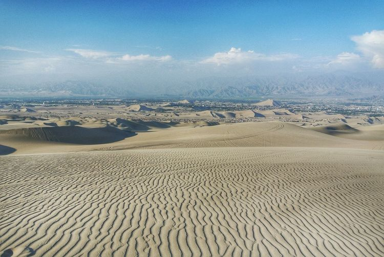 Aerial view of desert against sky