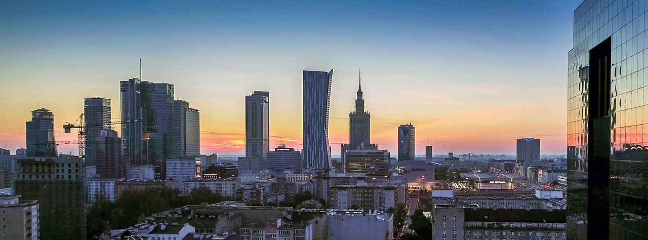 Panorama of Warsaw center at sunrise Architecture Building Exterior Built Structure Business Finance And Industry City Cityscape Day Development Downtown District Dusk Financial District  Flying High Modern No People Office Park Outdoors Sky Skyscraper Sunset Tower Travel Destinations Urban Skyline