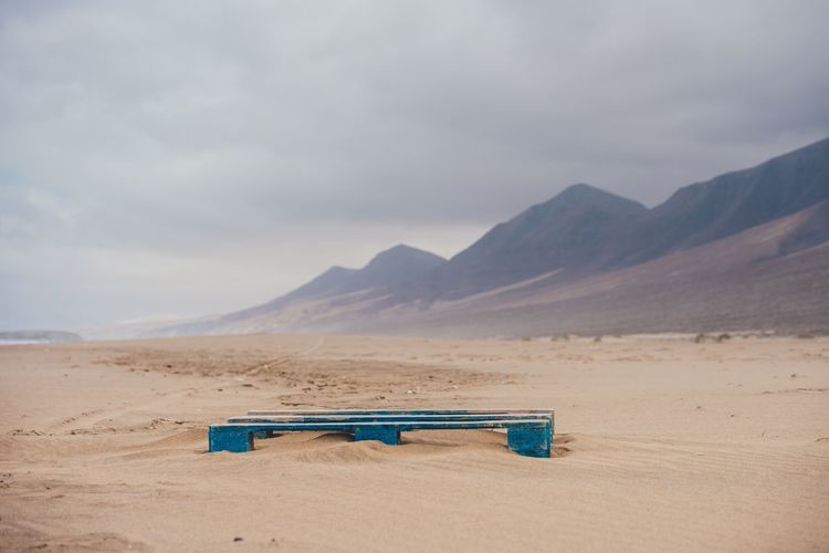 Playa Arena Pale Mountain Sky Cloud - Sky Scenics - Nature Tranquil Scene Non-urban Scene Landscape Nature Environment Mountain Range No People Tranquility Beauty In Nature Land Day Sand Desert Outdoors Remote Climate