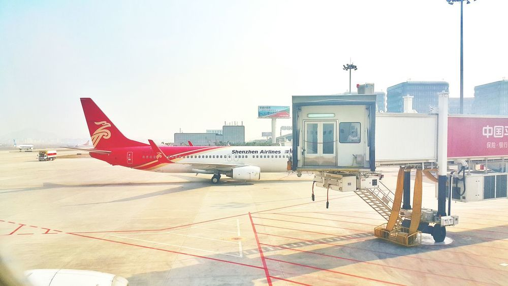 China Photos Boarding In The Terminal Returning Home Airport Airplane At The Airport From An Airplane Window Streamzoofamily