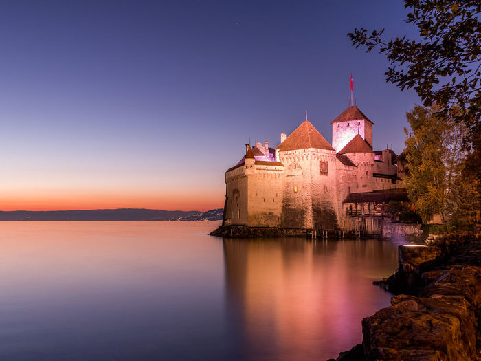 Chateau De Chillon Chillon Castle Geneva Lake Architecture Beauty In Nature Building Exterior Built Structure Clear Sky Nature Night No People Outdoors Place Of Worship Reflection Religion Scenics Sea Sky Spirituality Sunset Tranquility Travel Destinations Water