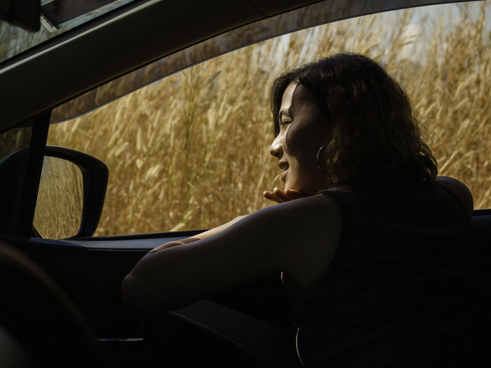 Side view of woman in car