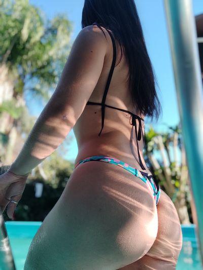Midsection of woman in bikini