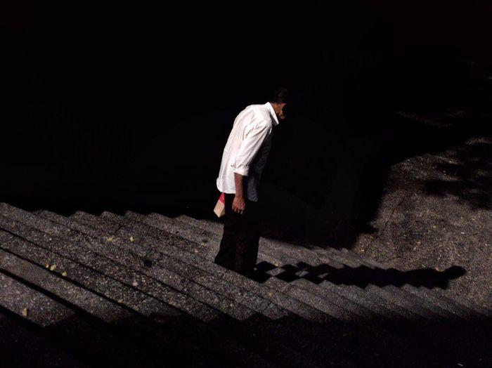 Full length of a man walking on floor at night