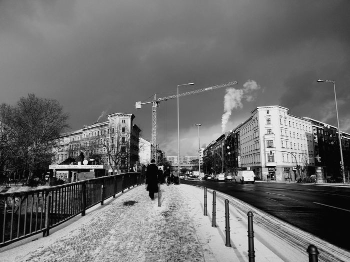 Winter made it to Berlin. For a day. Crane Crane - Construction Machinery City Snow Cold Temperature Winter Mountain Sky Architecture Building Exterior Built Structure Office Building Urban Skyline
