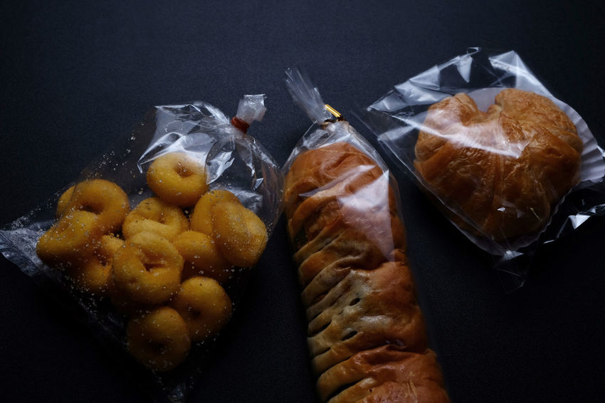 Pastry and bread warped in plastic bag ... from street market in Thailand Bakery Bread Close-up Day Dessert Food Food And Drink Freshness Indoors  Indoors  No People Pastry Plastic Plastic Bag Ready-to-eat Street Food Street Market In Thailand Sweet Food Thai Street Food