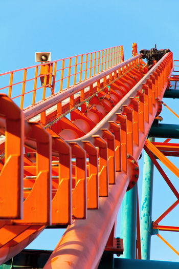 Roller Coaster Track Fun Roller Coaster Track Amusement Park Clear Sky Day Fun Park No People Orange Color Outdoors Roller Coaster Roller Coaster Structure Sky Theme Park