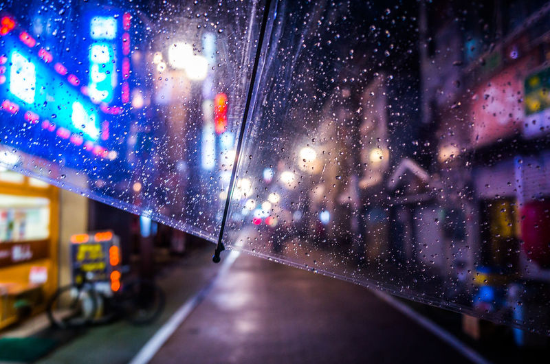 From My Umbrella ◀️☔️🌃 Dreamer's Vision Looking Into The Future Walk This Way Showing Imperfection Abstract Atmospheric Mood Bokeh Capture The Moment Enjoying Life EyeEm Best Shots EyeEm Gallery From My Point Of View Reflection Light And Shadow Night Night Lights Outdoors Rain Raindrops Rainy Days Still Life Street Urban Exploration Wet Let's Go. Together. Sommergefühle EyeEm TOA 2017 Neon Life Stories From The City End Plastic Pollution HUAWEI Photo Award: After Dark