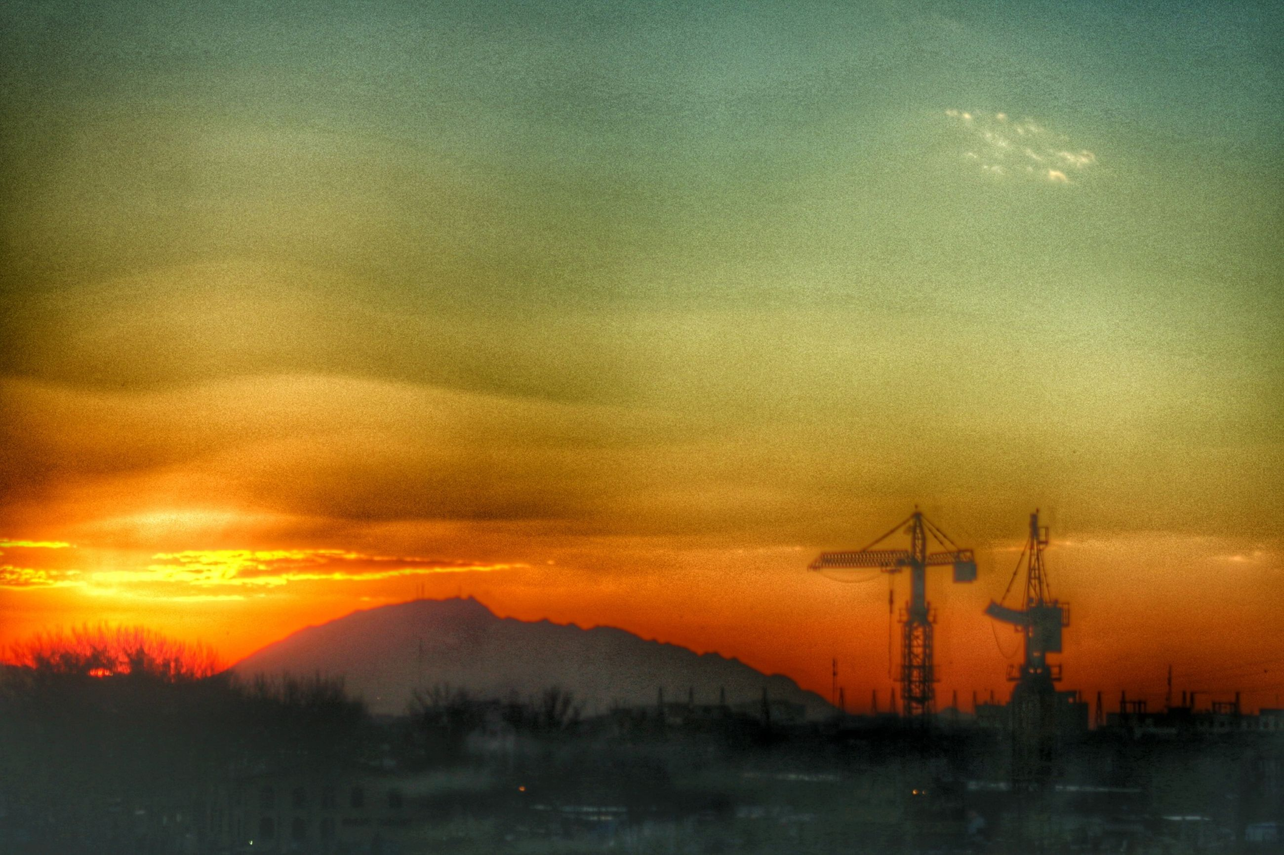 sunset, orange color, fuel and power generation, alternative energy, silhouette, wind turbine, scenics, wind power, sky, environmental conservation, renewable energy, beauty in nature, windmill, tranquil scene, nature, tranquility, idyllic, water, crane - construction machinery, landscape