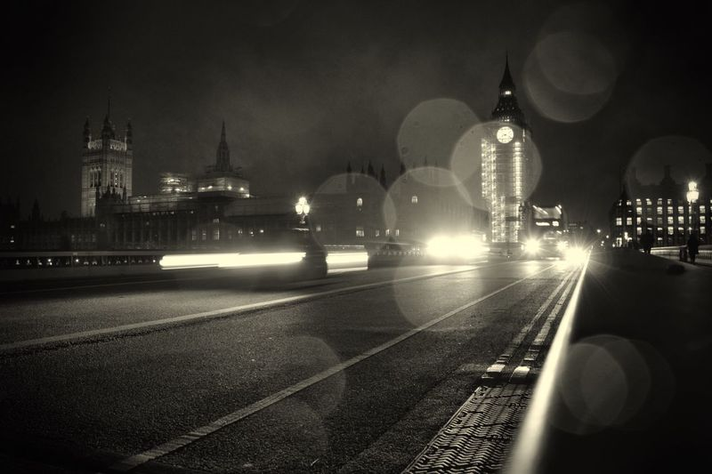 Black And White Friday London at night Illuminated Night Transportation Speed Mode Of Transport Architecture Built Structure Outdoors Road Light Trail Low Angle View London Streets The Week On EyeEm London At Night  Night Lights Big Ben England, UK Blackandwhite Bw Motion Road City No People Sky Black And White Friday