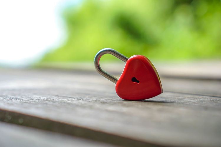 Red keys that are heart shaped, ideas, love, Valentine's Day. Abstract Background Beach Beautiful Beauty Bridge Celebration Closed Closeup Color Concept Coral Couple Day Decoration Design Fashion Flowers Happy Heart Holiday Isolated Key Living Lock Love Loyalty Message Metal Mothers Nature Padlock Paris Railing Red Romance Romantic Safety Security Shape Shaped Style Summer Sweetheart Symbol Valentine Valentines Vintage Wedding White Selective Focus Close-up No People Still Life Single Object Outdoors Wood - Material Table Green Color Heart Shape Absence Park - Man Made Space Plastic Park Focus On Foreground Personal Accessory