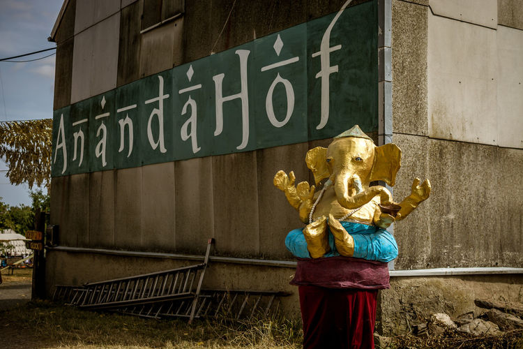 Art And Craft Architecture Representation Human Representation Sculpture Text Built Structure Building Exterior Statue Communication Day No People Western Script Male Likeness Sign Creativity Building Information Craft Outdoors Ganesha