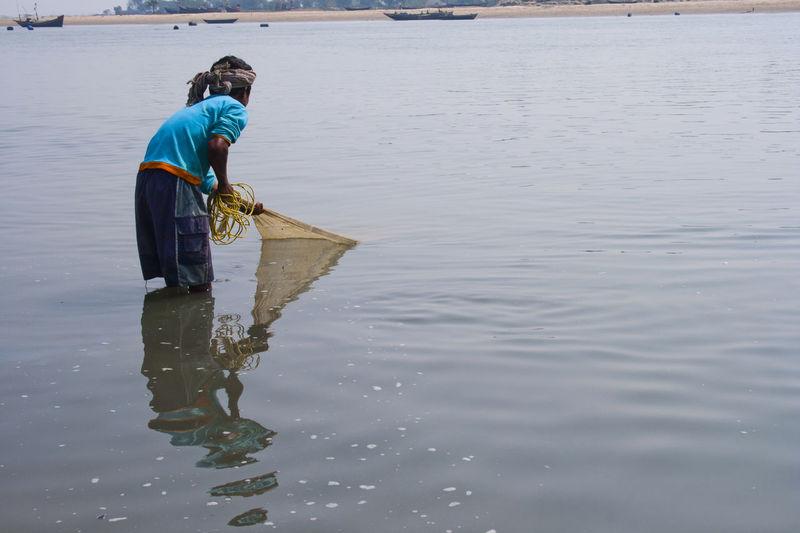 Man working in lake