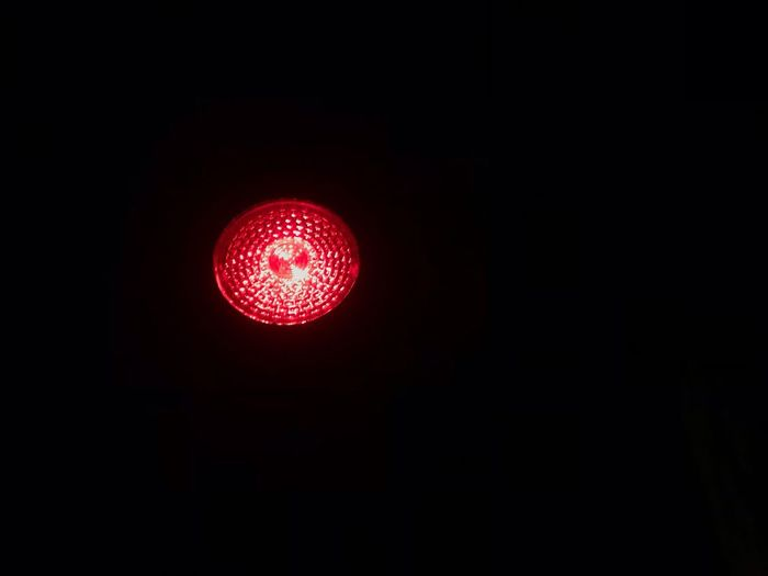 Illuminated Red No People Night Light Red Light Lighting Equipment Copy Space Light - Natural Phenomenon Sign Stoplight Low Angle View Indoors  Road Sign Circle Electricity  Electric Light Guidance Dark Black Background