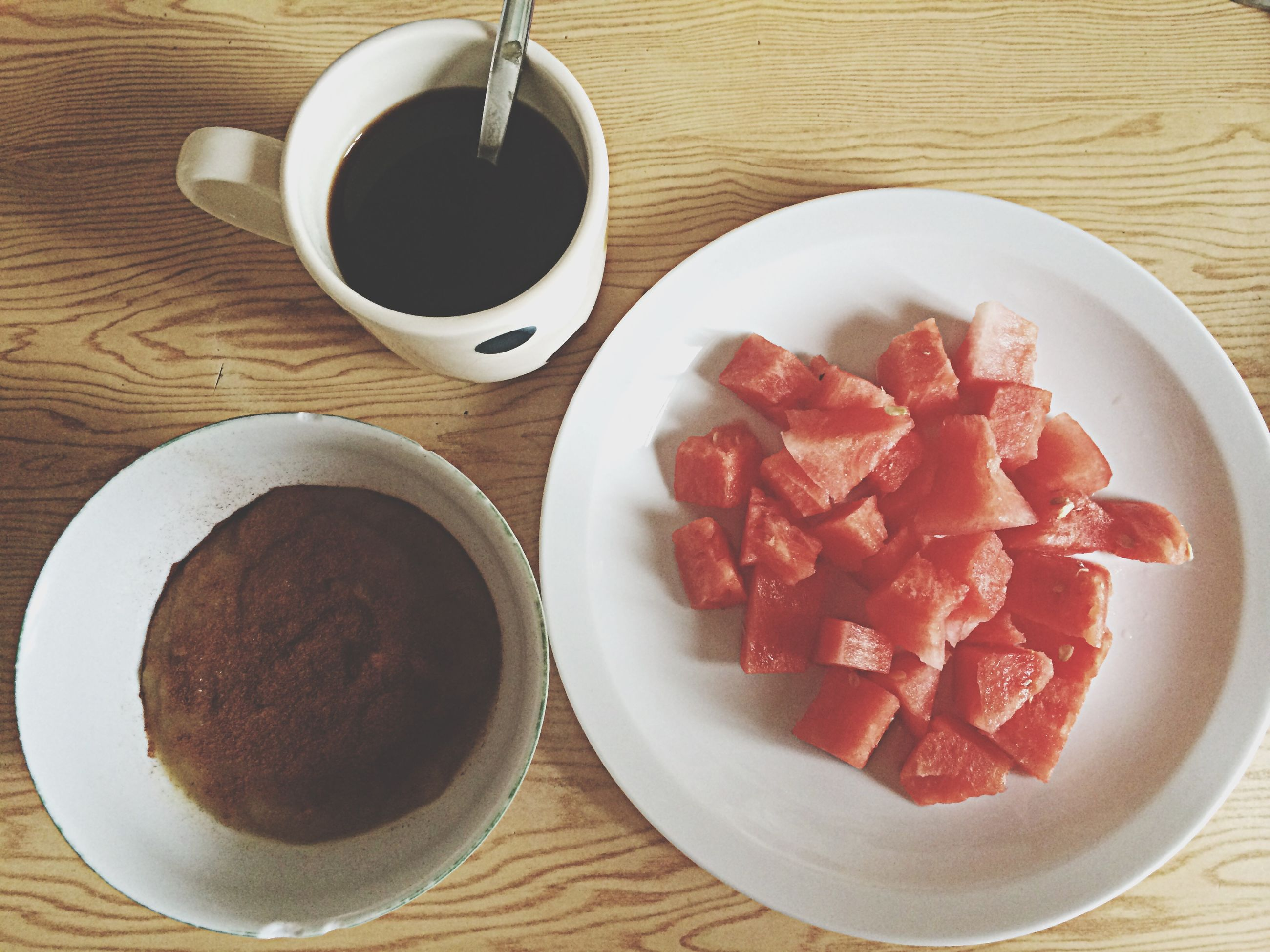 food and drink, indoors, freshness, table, food, healthy eating, still life, plate, high angle view, directly above, red, bowl, drink, ready-to-eat, refreshment, fruit, spoon, close-up, coffee cup, coffee - drink