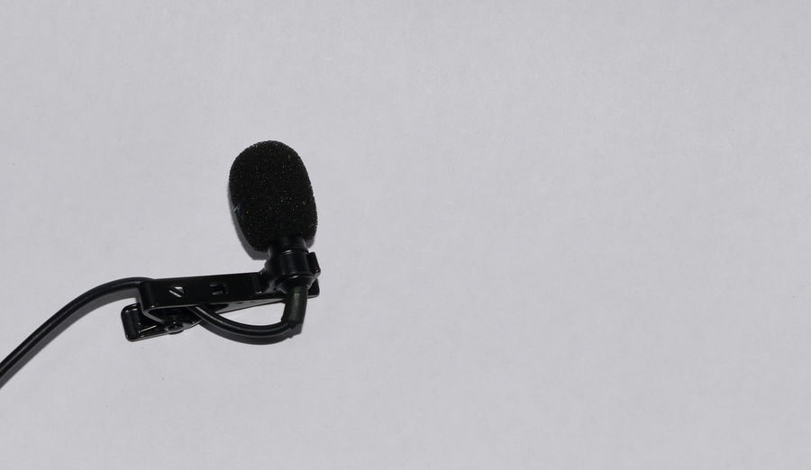 Lapel mic isolated in white background Arts Culture And Entertainment Black Color Close-up Communication Copy Space Cut Out High Angle View Lapel Metal Microphone Music No People Single Object Studio Shot White Background