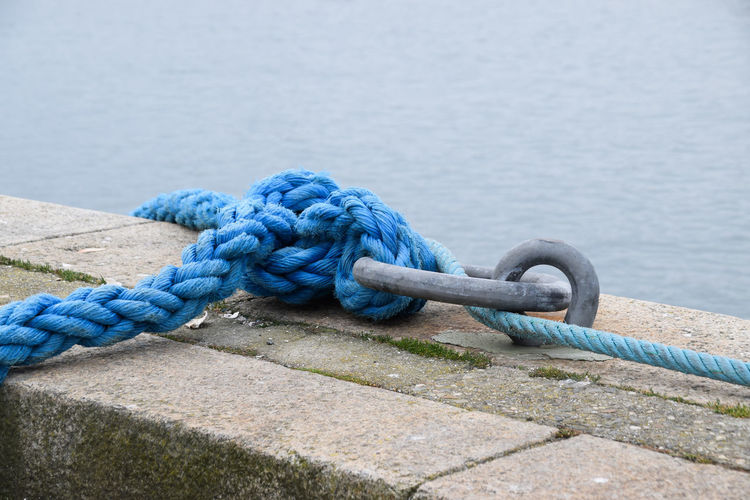 Close-up of rope tied at pier