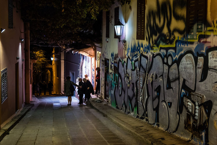 Rear view of a man on woman walking in city at night