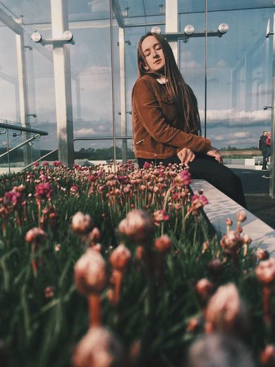 The Portraitist - 2017 EyeEm Awards Flower Growth One Person Real People Plant Nature Day Young Women Lifestyles Women Smiling Outdoors Young Adult Fragility Beauty In Nature Freshness Greenhouse Sky People The Week On EyeEm