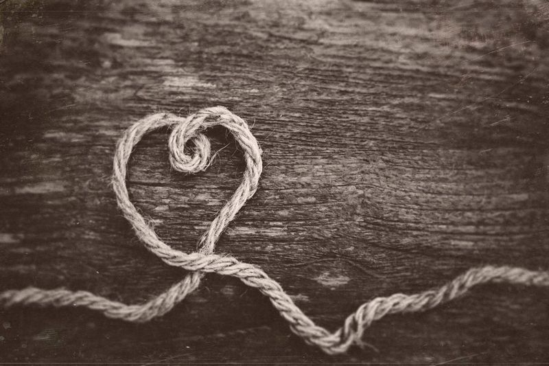 High angle view of heart shape on rope on table