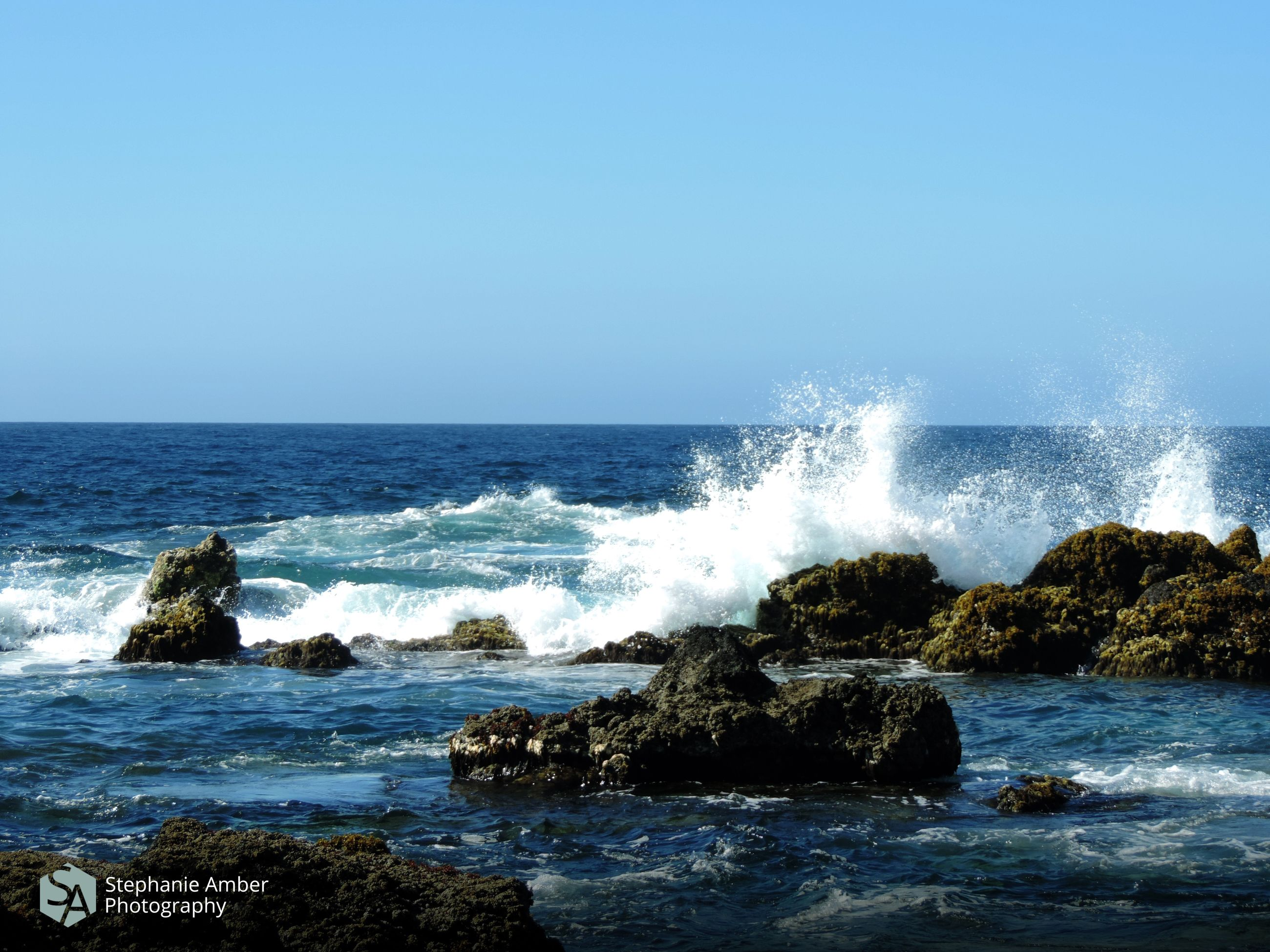 sea, water, motion, wave, sky, horizon, horizon over water, rock, power in nature, beauty in nature, splashing, power, solid, rock - object, sport, clear sky, nature, no people, scenics - nature, hitting, breaking, crash, outdoors