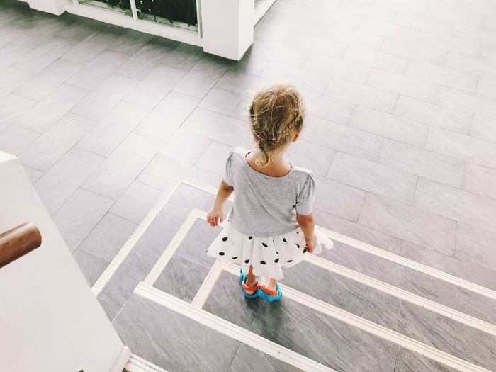 High angle view of girl standing on steps
