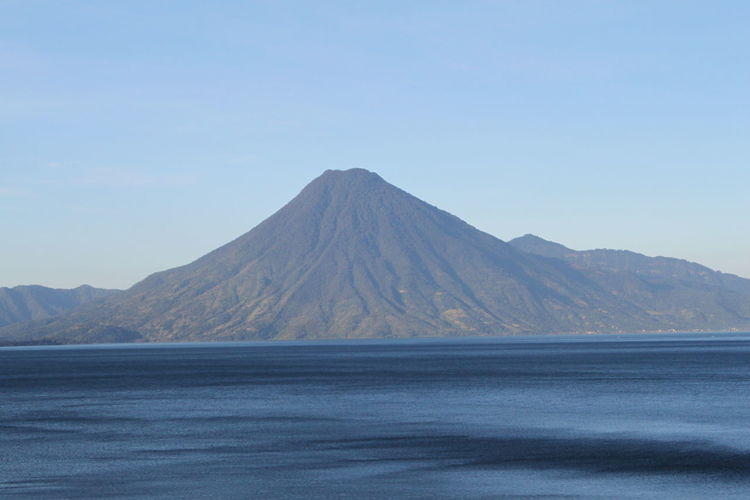 Atitlan Lake Lake Atitlan Guatemala Volcanoes Atitlan Beauty In Nature Clear Sky Day Lake Atitlán Landscape Mountain Nature No People Outdoors Physical Geography Scenics Sky Tranquil Scene Tranquility Volcan San Pedro Volcanic Landscape Volcano Windswept