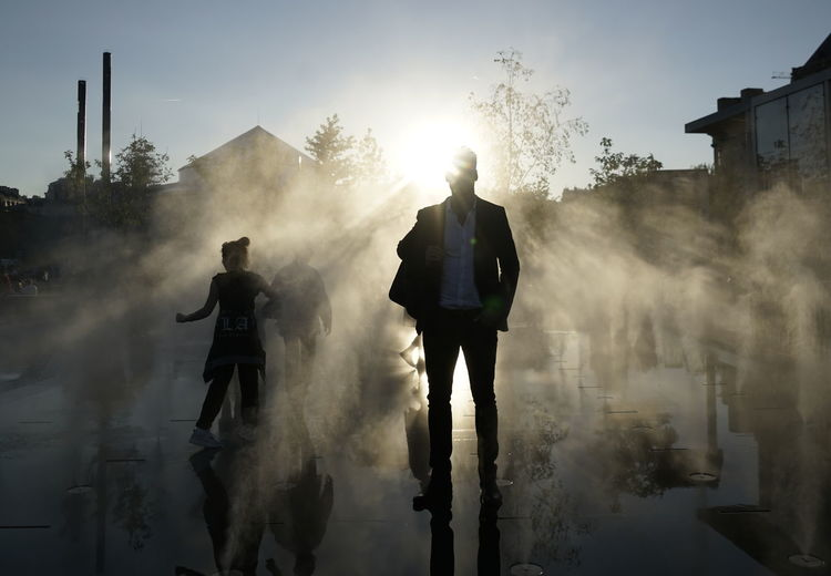 Mysterious businessman Mysterious Man City Drizzle Fog Foggy Full Length Lifestyles Men Mysterious Business Man Mysterious Businessma Nature Outdoors People Pollution Real People Silhouette Sky Smoke - Physical Structure Standing