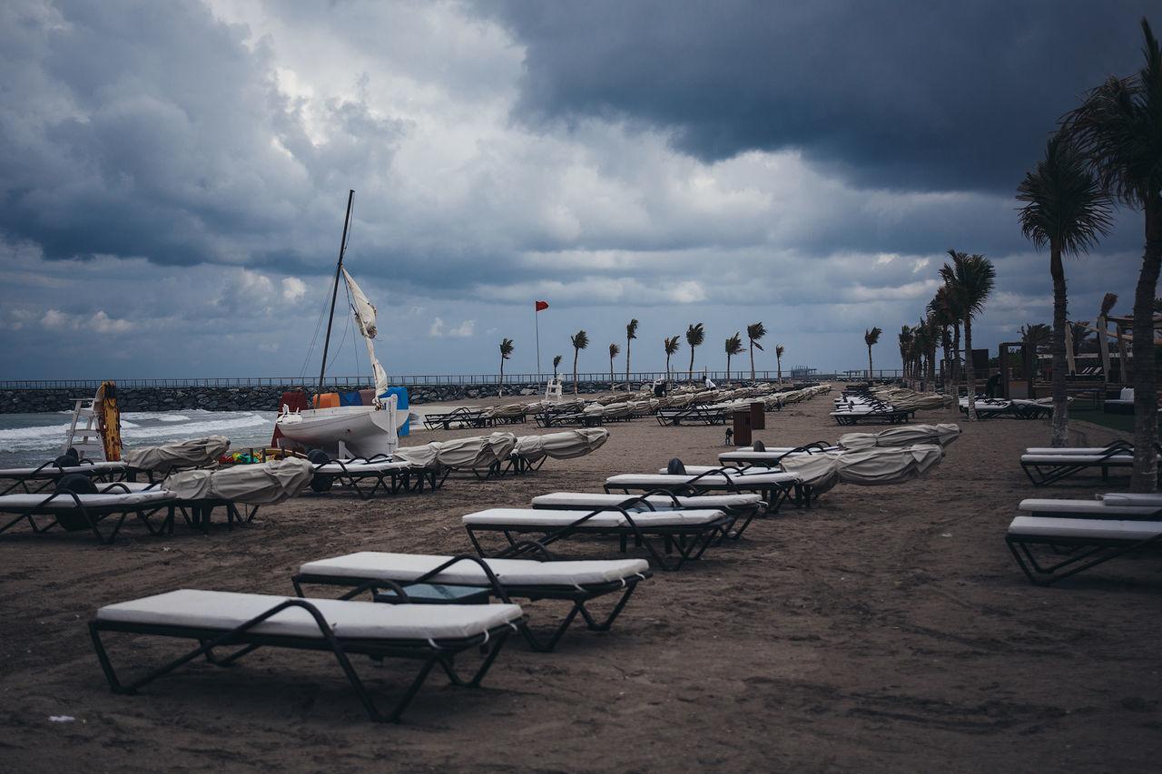 SAILBOATS MOORED ON BEACH