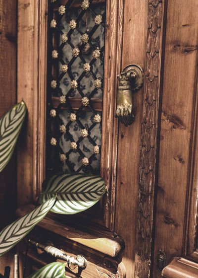 Brown Close-up Closed Closet Day Door Doorknob Entrance Furniture House Indoors  Knob No People Pattern Protection Safety Security Wood Wood - Material