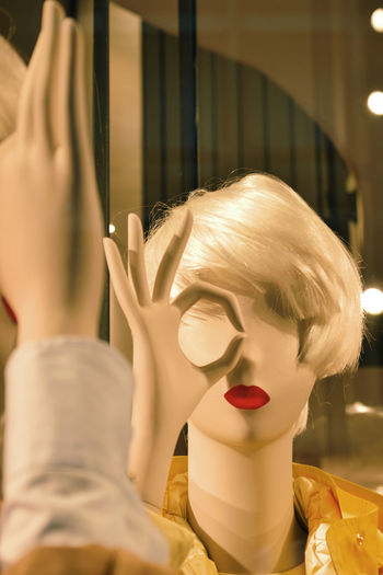 Close-Up Of Mannequin By Mirror At Shop