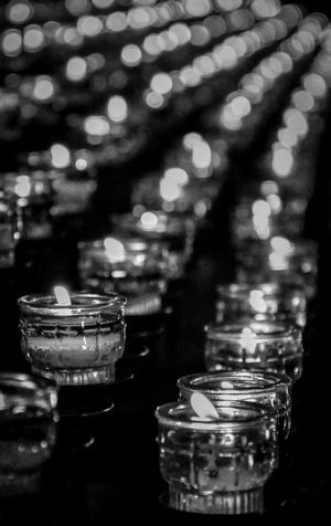 Blackandwhite Burning Candle Celebration Close-up Diya - Oil Lamp Flame Focus On Foreground Glowing Heat - Temperature Illuminated In A Row Indoors  Large Group Of Objects Light And Shadow Lighting Equipment Night No People Place Of Worship Religion Selective Focus Spirituality Tea Light Tradition