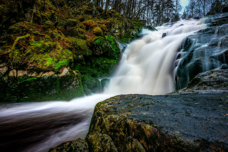 Long Exposure Image Of Waterfall In Forest