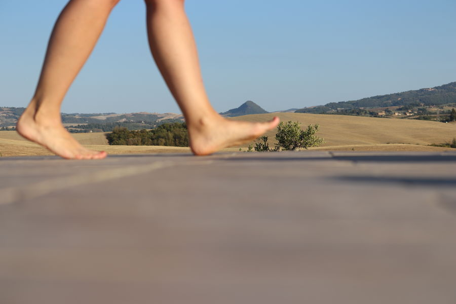 Walking in the countryside Advertising Green MR7 Toscana Beauty Beauty In Nature Blue Canon Clear Sky Communication Countryside Day Eos77D Feet Human Leg Italy Lifestyles Magazine Nature Outdoors Sky Sunlight Women