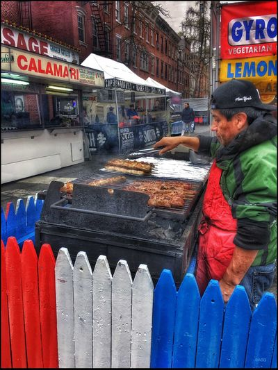 Street Fair on West 4th St. - 4/9/16 Enticing Smell EyeEm StreetPhotography, NYC IPhoneography 6s Italian Food Man W/ Skewers Preparing Food On The Barbie Showcase April Opportunistic Images On The Go Live Love Shop