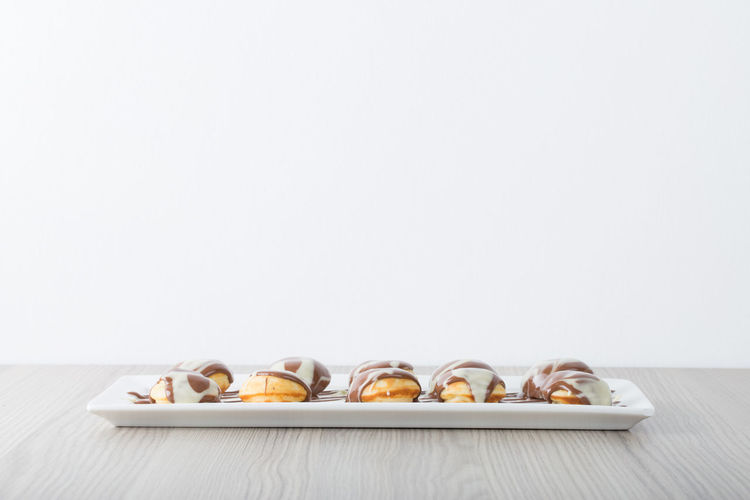 High angle view of cupcakes on table against white background
