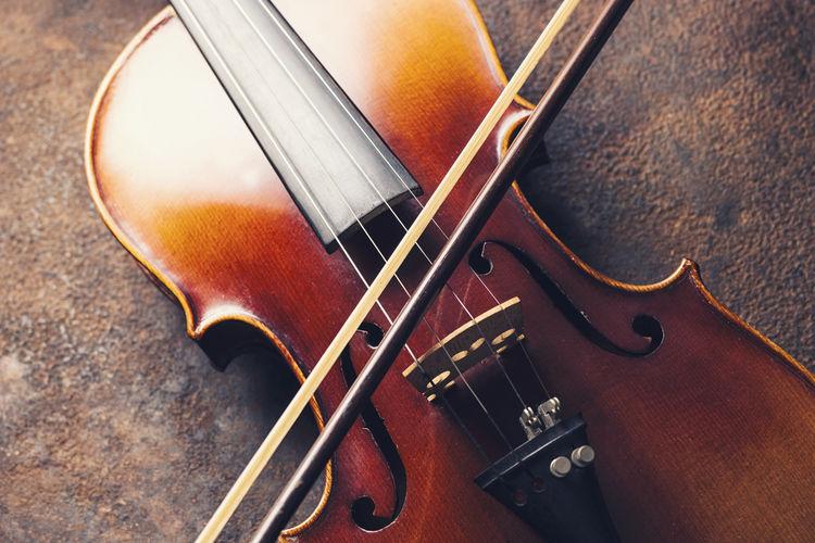 High Angle View Of Violin On Floor