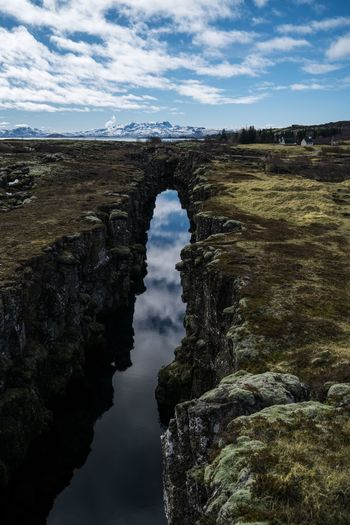 Tectonix. Sky Nature Cloud - Sky Outdoors Water Day Beauty In Nature Landscape Scenics Roadtrip Iceland Memories Iceland_collection Iceland Thingvellir National Park þingvellir Nature Water Reflections Reflection Reflections Skyporn Sky And Clouds River Gorge Beauty In Nature Nature_collection