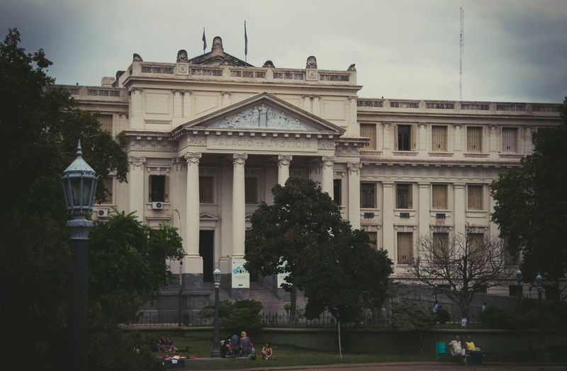 Facade of historic building against sky