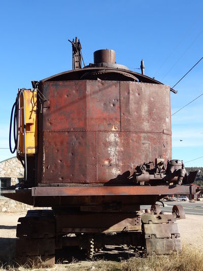 1923 Panama Canal shovel Steam Engine Abandoned Clear Sky Damaged Day Mining Equipment Outdoors Rusty Shovel Sky Sunlight