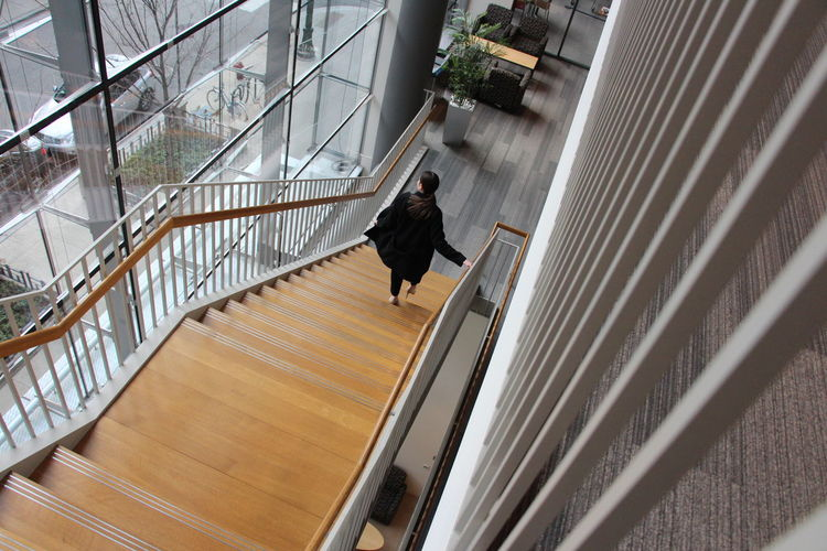 A woman walks down the steps in Chicago Chicago Chicago Architecture Architecture Staircase One Person Railing Steps And Staircases Walking Motion Full Length High Angle View on the move Built Structure Adult Business Person Woman Woman Portrait Females Fashion Fashion Photography Fashion Model Urban Beautiful Design Interior Design