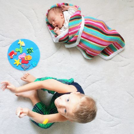 Baby boy with his big brother Baby Babyboy Big Brother Brother Brothers Child Children Cute Family Floor Fun Infant Kid Kids Little Love Newborn Play Time Playing Portrait Room Siblings Toddler  Together Toys